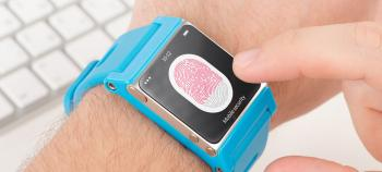 Close-up of a smartwatch processing a fingerprint scan.